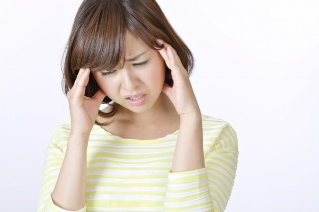 頭痛の人画像